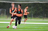 George Byers vies for possession with Yan Dhanda of Swansea City during the Swansea City Training Session at The Fairwood Training Ground, Wales, UK. Tuesday 11th September 2018