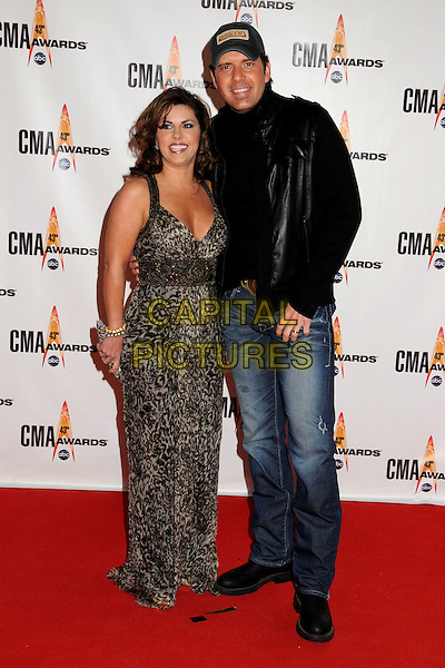 TAMMY JO ATKINS & RODNEY ATKINS.43rd Annual CMA Awards, Country Music's Biggest Night, held at the Sommet Center, Nashville, Tennessee, USA..November 11th, 2009.full length married husband wife grey gray leopard print dress jeans denim black suit jacket .CAP/ADM/LF.©Laura Farr/AdMedia/Capital Pictures.