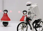 "October 4, 2016, Chiba, Japan - Japan's electronic parts maker Murata Manufacturing displays a formation dancing robots, known as the ""Murata Cheerleaders,"" and a bicycle robot ""Murata Seisaku-kun"" at the CEATEC Japan 2016 in Chiba, suburban Tokyo on Tuesday, October 4, 2016. Asia's largest electronics trade show CEATEC started here through October 7.   (Photo by Yoshio Tsunoda/AFLO) LWX -ytd-"