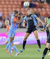 Sofia Huerta (11) of the Chicago Red Stars wins a header over Poliana (2) of the Houston Dash in the first half on Saturday, April 16, 2016 at BBVA Compass Stadium in Houston Texas.