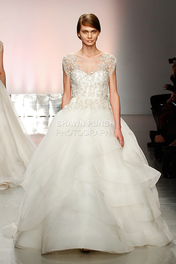 Model walks runway in a bridal gown from the Rita Vinieris Spring 2015 Bridal collection, during New York Bridal Fashion Week, April 11, 2014.