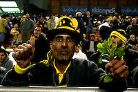 "A Mizrahi ((Jews who came from Asia and Africa) Beitar Jerusalem soccer fan draped in the team's black-and-yellow colours support his team during the match for the league against Hapoel Tel Aviv in the Jerusalem stadium ""Tedy"". Hapel Tel Aviv is considered by Betar fans  the worst enemy in the league which represents the Ashkenazy (European born) lefty club.  Beitar won the match 2 -1. Beitar Jerusalem FC was founded in the 1930's by the right-wing Revisionist Zionist movement, which later formed the Israeli Likud political party, during the British Mandate rule over Palestine. The chanting of the club is racist and mainly against Arabs. The team is the only one in the Israeli league to have never had an Arab player. Beitar is seen as the right wing and Mizrahi  club. Photo by Quique Kierszenbaum"