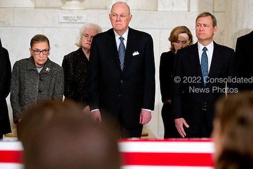 United States Supreme Court Justices Ruth Bader Ginsburg, left,  Anthony M. Kennedy, and Chief Justice John G. Roberts, Jr., attend a private ceremony in the Great Hall of the US Supreme Court where late Supreme Court Justice Antonin Scalia lies in repose in Washington, DC on Friday, February 19, 2016. <br /> Credit: Jacquelyn Martin / Pool via CNP
