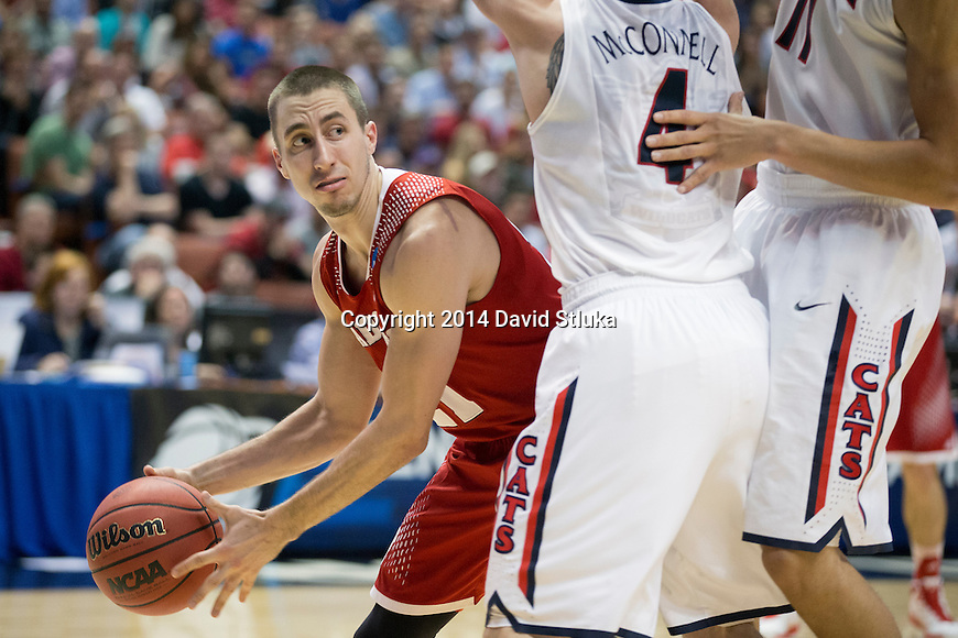 Wisconsin Badgers guard Josh Gasser (21) handles the ball during the Western Regional Final NCAA college basketball tournament game against the Arizona Wildcats Saturday, March 29, 2014 in Anaheim, California. The Badgers won 64-63 (OT). (Photo by David Stluka)