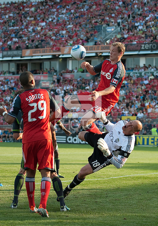 Toronto FC defender Ty Harden #20 and Seattle Sounders FC goalkeeper Kasey Keller #18 in action during an MLS game between the Seattle Sounders FC and the Toronto FC at BMO Field in Toronto on June 18, 2011.