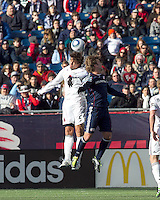 DC United defender Dejan Jakovic (5) and New England Revolution forward Zack Schilawski (15) battle for head ball. In a Major League Soccer (MLS) match, the New England Revolution defeated DC United, 2-1, at Gillette Stadium on March 26, 2011.