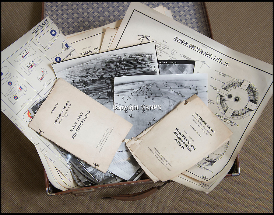 BNPS.co.uk(01202 558833)<br /> Pic: C&TAuctions/BNPS<br /> <br /> Found in a french flea market - a Top Secret 'how to' guide to D-Day.<br /> <br /> Fascinating top secret documents and photos of the extensive planning that went into the Normandy invasion have emerged after 72 years.<br /> <br /> Incredibly detailed plans of Nazi defences, high resolution photographs, weekly intel reports and even analysis of the German weapons they were likely to face are included in the extraordinary sale.<br /> <br /> One photo taken at zero feet shows German troops scattering across a beach as a low-level RAF aircraft sweeps by to capture the plethora of anti-landing obstacles.<br /> <br /> Other images show the famous coastline with key cliff-top targets that had to be destroyed on D-Day.<br /> <br /> The archive is being sold by C&T Auctions of Kent.