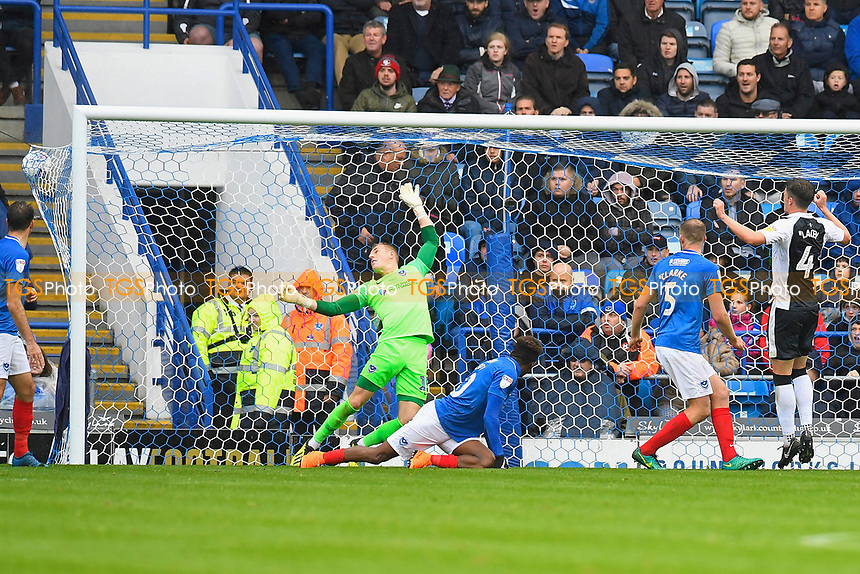 Alex Lacey of Gillingham right jumps in the arias his shot beats Craig MacGillivray of Portsmouth and bulges the net during Portsmouth vs Gillingham, Sky Bet EFL League 1 Football at Fratton Park on 6th October 2018