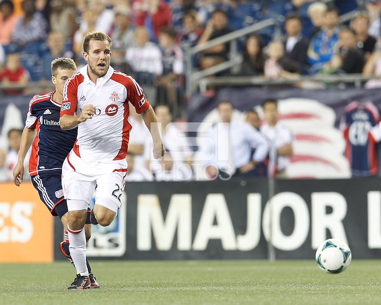 Toronto FC forward Jeremy Brockie (22) on the attack.  In a Major League Soccer (MLS) match, Toronto FC (white/red) defeated the New England Revolution (blue), 1-0, at Gillette Stadium on August 4, 2013.
