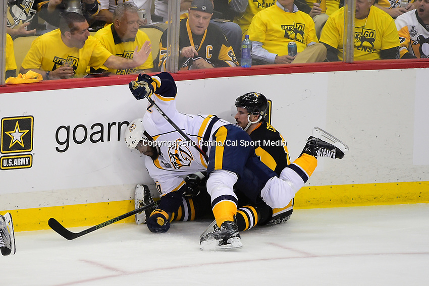 May 31, 2017: Nashville Predators defenseman P.K. Subban (76) falls into Pittsburgh Penguins center Sidney Crosby (87) during game two of the National Hockey League Stanley Cup Finals between the Nashville Predators  and the Pittsburgh Penguins, held at PPG Paints Arena, in Pittsburgh, PA. The Penguins defeat the Predators 4-1 and lead the series 2-0. Eric Canha/CSM