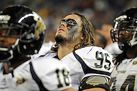 26 December 2010:  FIU defensive tackle Andrew Mattox (93) watches the large video display as Toledo attempts a two-point conversion in the fourth quarter as the FIU Golden Panthers defeated the University of Toledo Rockets, 34-32, to win the 2010 Little Caesars Pizza Bowl at Ford Field in Detroit, Michigan.