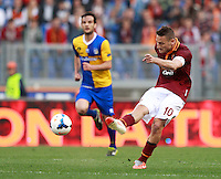Calcio, Serie A: Roma vs Parma. Roma, stadio Olimpico, 2 aprile 2014.<br /> AS Roma forward Francesco Totti kicks the ball during the Italian Serie A football match between AS Roma and Parma at Rome's Olympic stadium, 2 April 2014.<br /> UPDATE IMAGES PRESS/Isabella Bonotto