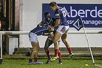 Drew Locke of London Scottish (left) celebrates scoring a try with Matt Williams (centre) and Jason Harries of London Scottish (right) during the Greene King IPA Championship match between London Scottish Football Club and Nottingham Rugby at Richmond Athletic Ground, Richmond, United Kingdom on 16 October 2015. Photo by David Horn.