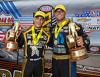 Sep 5, 2016; Clermont, IN, USA; NHRA top fuel driver Tony Schumacher (left) and teammate, funny car driver Matt Hagan celebrate after winning the US Nationals at Lucas Oil Raceway. Mandatory Credit: Mark J. Rebilas-USA TODAY Sports