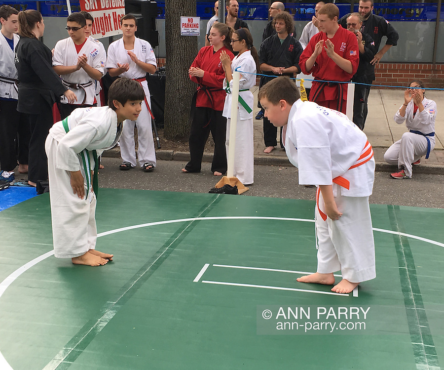 Merrick, New York, USA. 27th September 2015. Two young students of Goshinkan Jujitsu Dojo Family Self Defense Center bow to each other in repect after demonstrating jujitsu moves at the Merrick Fall Festival
