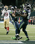 Seattle Seahawks running back Marshawn Lynch (24) celebrates with wide receiver Doug Baldwin (89) after scoring on a 14-yard run against the San Francisco 49ers in the third quarter at CenturyLink Field in Seattle, Washington on September 15, 2013.  Lynch finished with 135 total yards, including 98 yards rushing yards on 28 carries, scored three touchdowns in the Seattle Seahawks 29-3 win over the 49ers .  The Seahawks beat the 49ers 29-3. ©2013. Jim Bryant Photo. ALL RIGHTS RESERVED.