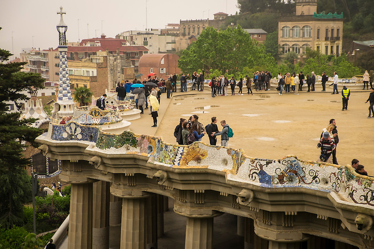 The roof-top terrace of Gaudi's Park Guell provides a sweeping view over the outskirts of Barcelona.