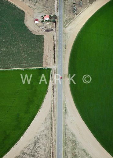 Red Truck between giant crop wheels, San Luis Valley, Colorado. July 2014