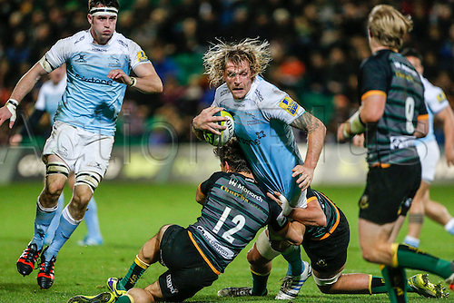 01.11.2014.  Northampton, England.  LV Cup Rugby. Northampton Saints versus Newcastle Falcons. Scott Macleod of Newcastle Falcons is tackled by Dom Waldouck (front) and Alex Woolford (rear) of Northampton Saints.   Final score: Northampton Saints 37-23 Newcastle Falcons.