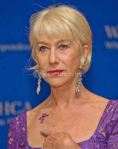 Helen Mirren points to her tattoo as she arrives for the 2016 White House Correspondents Association Annual Dinner at the Washington Hilton Hotel on Saturday, April 30, 2016.<br /> Credit: Ron Sachs / CNP<br /> (RESTRICTION: NO New York or New Jersey Newspapers or newspapers within a 75 mile radius of New York City)/MediaPunch