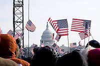 Spectators wave American flags in view of the Capitol Building during the inauguration of Barack Obama as the 44th president of the United States of America, Tuesday, Jan. 20, 2009, in Washington, D.C. (Heather Halstead/pressphotointl.com)