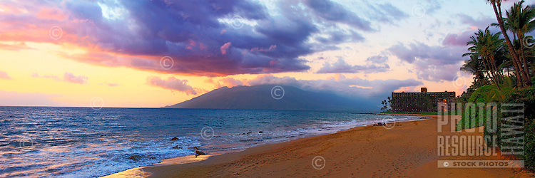 Keawakapu beach at sunset, with the Mana Kai resort and the West Maui mountains in the distance.