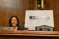 United States Senator Mazie Hirono (Democrat of Hawaii) questions Carlos Monje, Junior, the Director of Public Policy and Philanthropy at Twitter, and Neil Potts, the Public Policy Director at Facebook, on Capitol Hill in Washington DC on April 10, 2019.  Behind her, she displayed Google results showing theories that the Sandy Hook School shooting in 2012 were fake.<br /> Credit: Stefani Reynolds / CNP/AdMedia