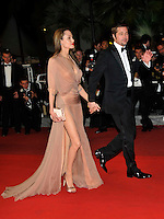 ANGELINA JOLIE &amp; BRAD PITT <br /> Leaving the premiere of &quot;Inglorious Basterds&quot;  at the Grand Theatre Lumiere  during the 62nd Cannes International Film Festival, Cannes, France, <br /> May 20th 2009.<br /> full length departures black suit tux tuxedo Tom Ford long beige peach silk dress maxi draped v-neck clutch bag satin shoes open toe cream couple leaving walking bow tie white shirt leg thigh slit split side profile sheer holding hands funny eyes shut<br /> CAP/PL<br /> &copy;Phil Loftus/Capital Pictures /MediaPunch ***NORTH AND SOUTH AMERICAS ONLY***