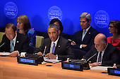 """(L-R, front row) United Nations Secretary-General Ban Ki-moon, United States President Barack Obama (center), His Excellency Haider Al-Abadi, Prime Minister of the Republic of Iraq (2nd row) Susan Rice, United States Ambassador to the United Nations (behind President Obama), Secretary of State John Kerry and Samantha Power (pink), United States Ambassador to the United Nations, attend the """"Leader's Summit on Countering ISIL and Countering Violent Extremism"""" at the United Nations Headquarters, New York, New York on September 29, 2015.  <br /> Credit: Anthony Behar / Pool via CNP"""