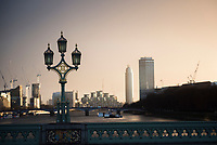 Westminster Bridge Lamp at sunset, with River Thames and Vauxhall behind, London, England