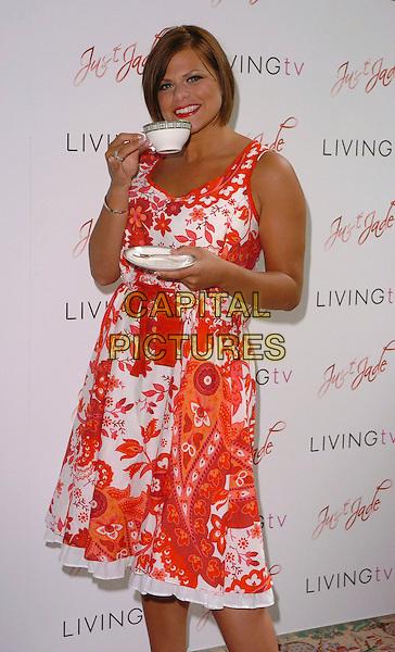 "JADE GOODY.Photocall at the Dorchester for her new reality show ""Just Jade"", London, UK..Msy 24th, 2006.Ref: CAN.half length orange white floral print dress ribbon drinking tea coffe cup saucer.www.capitalpictures.com.sales@capitalpictures.com.©Capital Pictures"