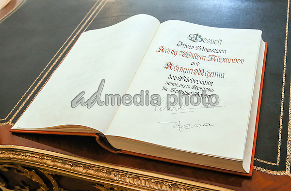 13 April 2016 - Munich, Germany - King Willem-Alexander writes into the guestbook during the meeting with Bavarian Prime Minister Horst Seehofer and his wife Karin. State visit of the Dutch Royal couple King Willem-Alexander and Queen Maxima in Munich, Germany. Photo Credit: Nickels/face to face/AdMedia