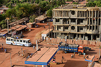 BURKINA FASO , Boulkiemdé Province, Koudougou, new construction of building, petrol station, public bus and truck loaded with animals