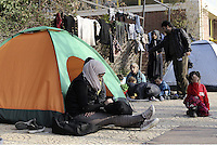 Pictured: Migrants in tents at the port Friday 26 February 2016<br /> Re: Hundreds of refugees that crossed the border from Turkey to the Greek islands, have arrived at the port of Piraeus near Athens, Greece