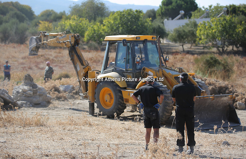 Pictured: Police officers oversee the diggers that work to clear the new site of the search, where rubble was deposited from the farmhouse where Ben Needham disappeared from in Kos, Greece. Thursday 06 October 2016<br />Re: Police teams led by South Yorkshire Police, searching for missing toddler Ben Needham on the Greek island of Kos have moved to a new area in the field they are searching.<br />Ben, from Sheffield, was 21 months old when he disappeared on 24 July 1991 during a family holiday.<br />Digging has begun at a new site after a fresh line of inquiry suggested he could have been crushed by a digger.