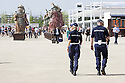 Local Police near the west entrance, Triulzia, at Expo 2015, Rho-Pero, Milan. In the background the People of food, statues of production designer Dante Ferretti. &copy; Carlo Cerchioli <br /> <br /> Polizia Locale vicino all'ingresso ovest, Triulzia, a Expo 2015, Rho-Pero, Milano. Sullo sfondo il Popolo del cibo le statue dello scenografo Dante Ferretti.