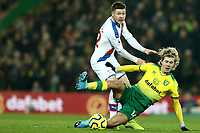 1st January 2020; Carrow Road, Norwich, Norfolk, England, English Premier League Football, Norwich versus Crystal Palace; Todd Cantwell of Norwich City tackles James McCarthy of Crystal Palace - Strictly Editorial Use Only. No use with unauthorized audio, video, data, fixture lists, club/league logos or 'live' services. Online in-match use limited to 120 images, no video emulation. No use in betting, games or single club/league/player publications