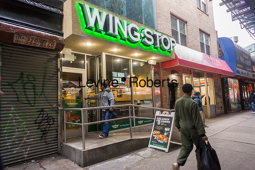 A branch of the Wingstop fast casual dining restaurant chain in Bushwick in Brooklyn in New York on Saturday, January 21, 2017. Fried chicken lovers can link their Winsgstop account with their Amazon Alexa and can order tasty chicken wings by voice. (© Richard B. Levine)
