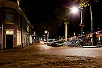 A view of a street at night in Delft, Holland