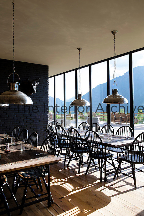 Plate glass windows in the hotel's restaurant offer spectacular views of the surrounding mountains