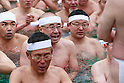 Participants dressed only in loincloths pray in a pool of freezing-cold water containing two large blocks of ice during the 62nd Annual Cold-Endurance Festival, Kanchu-Misogi, at Teppozu Inari Shrine on January 8, 2017, Tokyo, Japan. About 100 brave participants joined the purification ritual to pray for a healthy new year. (Photo by Rodrigo Reyes Marin/AFLO)