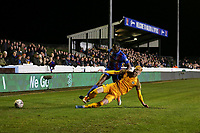 Ryan Haynes of Newport County tackles Kojo Awotwi of Maldon in front of a bumper crowd during Maldon & Tiptree vs Newport County, Emirates FA Cup Football at the Wallace Binder Ground on 29th November 2019