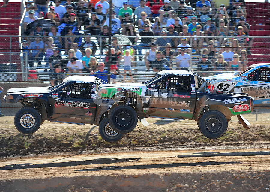 Apr 16, 2011; Surprise, AZ USA; LOORRS driver Chad George (42) races alongside Austin Kimbrell (88) during round 3 at Speedworld Off Road Park. Mandatory Credit: Mark J. Rebilas-