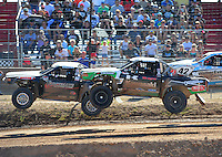 Apr 16, 2011; Surprise, AZ USA; LOORRS driver Chad George (42) races alongside Austin Kimbrell (88) during round 3 at Speedworld Off Road Park. Mandatory Credit: Mark J. Rebilas-