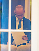 Senior Advisor for Policy Stephen Miller looks over some notes in the Oval Office prior to United States President Donald J. Trump delivering remarks on the United States Mexico Canada Agreement (USMCA) in the Rose Garden of the White House in Washington, DC on Monday, October 1, 2018.  The President  took questions on the agreement and on the Kavanaugh nomination.<br /> Credit: Ron Sachs / CNP