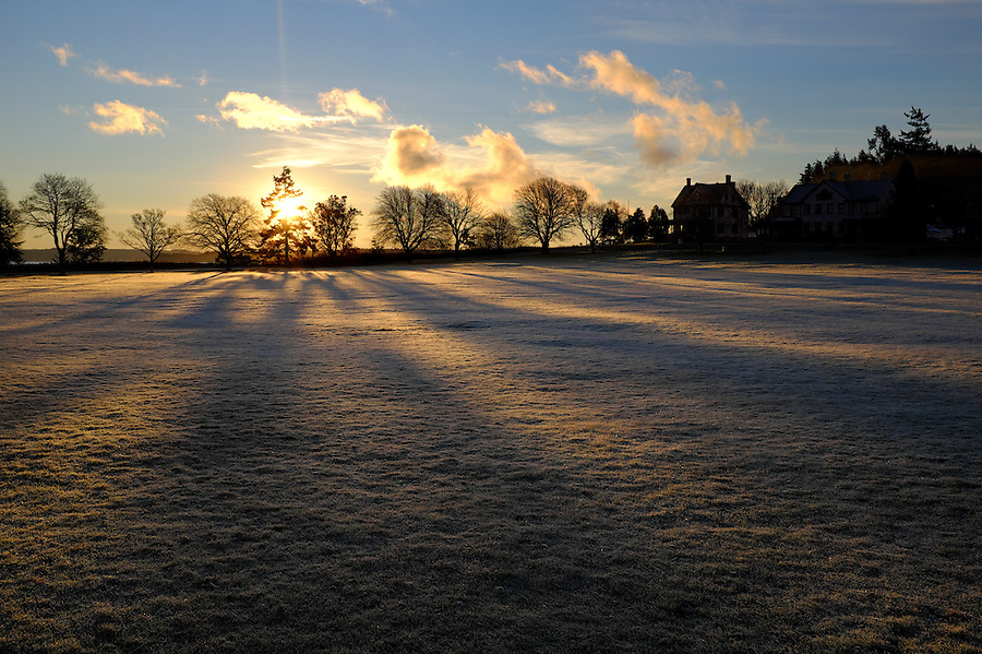 Sun rises over parade grounds, Fort Worden State Park, Port Townsend, Washington, USA