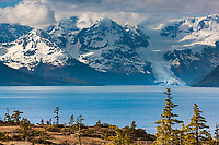 Tourists view Cascade glacier and the Chugach mountains across Port Wells in Prince William Sound, Alaska.