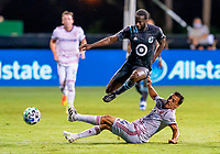 17th July 2020, Orlando, Florida, USA;  Minnesota United midfielder Kevin Molino (7) jumps over Real Salt Lake defender Donny Toia (4) during the MLS Is Back Tournament between the Real Salt Lake versus Minnesota United FC on July 17, 2020 at the ESPN Wide World of Sports, Orlando FL.