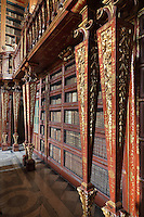 Bookcases with Chinese motifs, lacquer and gilding by Manuel da Silva, in the Red Room of the Joanina Library, or Biblioteca Joanina, a Baroque library built 1717-28 by Gaspar Ferreira, part of the University of Coimbra General Library, in Coimbra, Portugal. The Casa da Livraria was built during the reign of King John V or Joao V, and consists of the Green Room, Red Room and Black Room, with 250,000 books dating from the 16th - 18th centuries. The library is part of the Faculty of Law and the University is housed in the buildings of the Royal Palace of Coimbra. The building is classified as a national monument and UNESCO World Heritage Site. Picture by Manuel Cohen