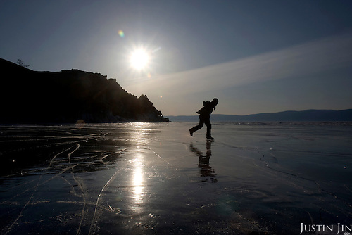 Justin skates on the coast of Olkhon Island on Lake Baikal in Siberia, Russia. .They are a group of five people: Justin Jin (Chinese-British), Heleen van Geest (Dutch), Nastya and Misha Martynov (Russian) and their Russian guide Arkady. .They pulled their sledges 80 km across the world's deepest lake, taking a break on Olkhon, the world's forth-largest lake-bound island. They slept two nights on the ice in -15c. .Baikal, the world's largest lake by volume, contains one-fifth of the earth's fresh water and plunges to a depth of 1,637 metres..The lake is frozen from November to April, allowing people to cross by cars and lorries.